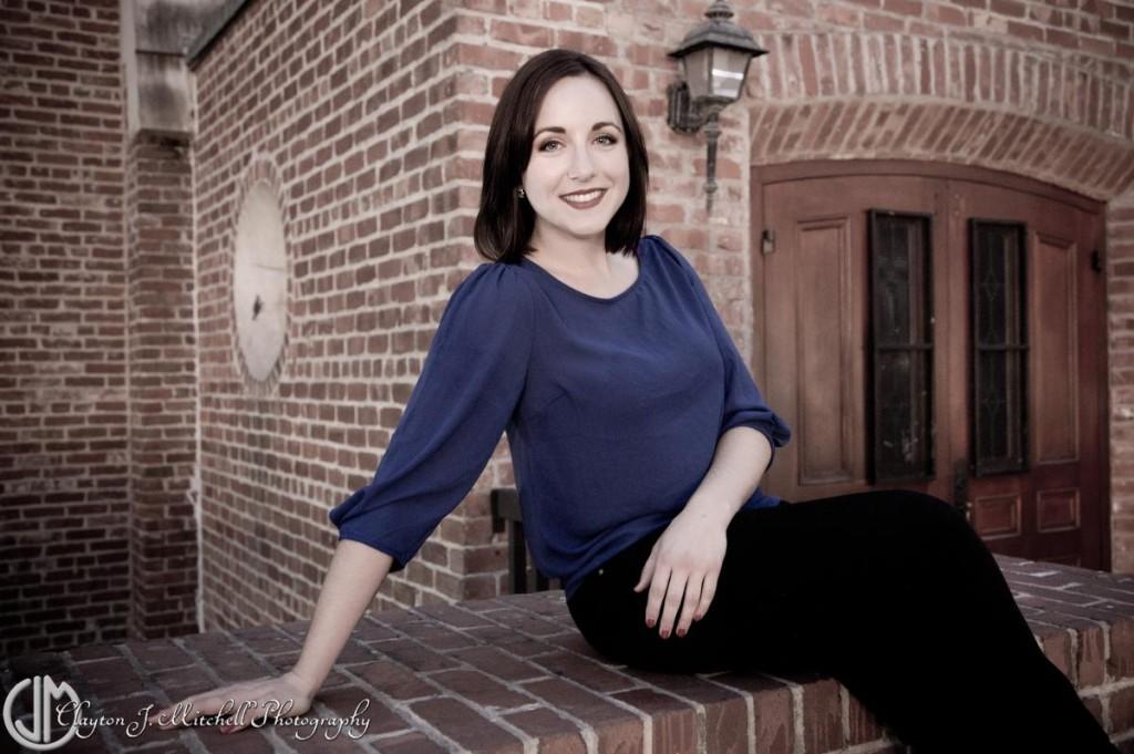 woman sitting on brick building