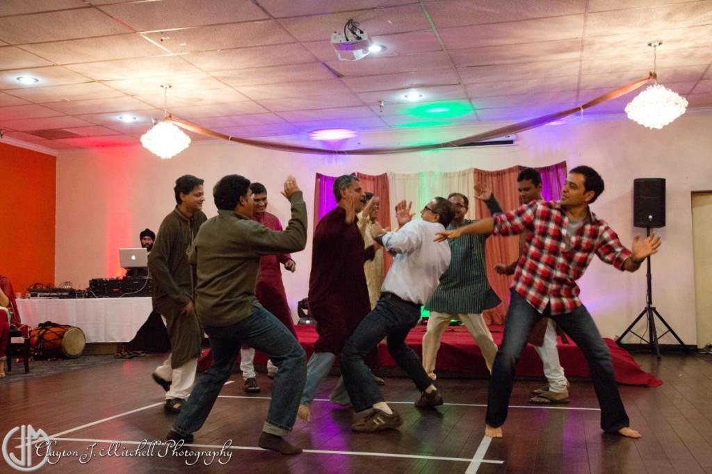 Indian men dancing