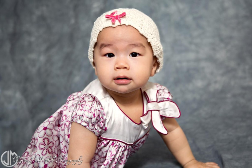 baby girl wearing white hat