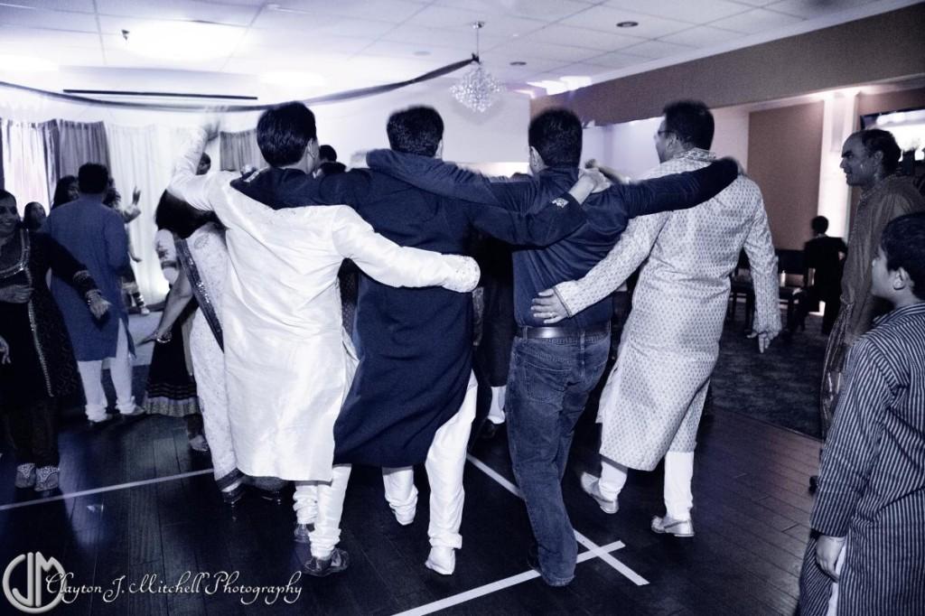 men dancing at Diwali party