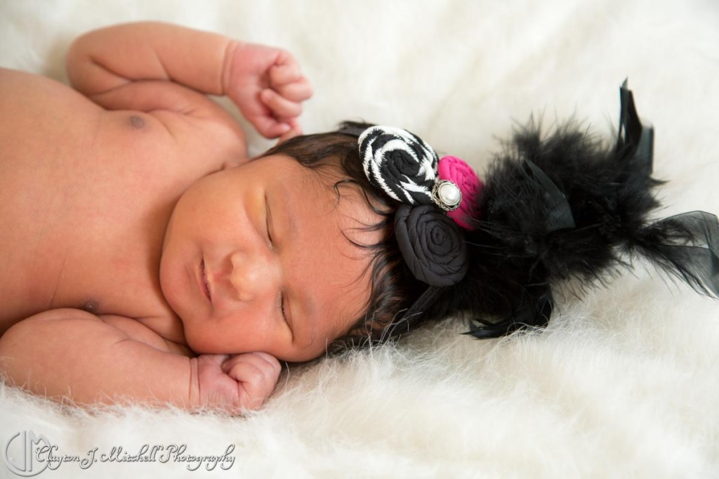baby wearing feather headband