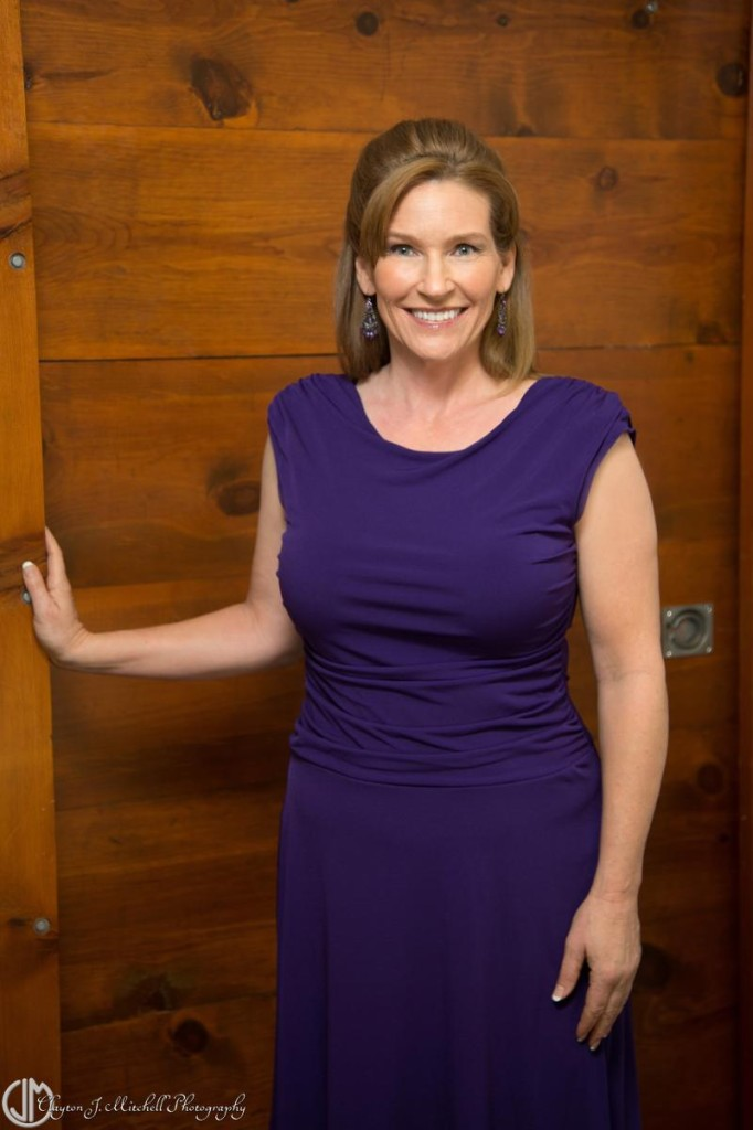 woman wearing a purple dress