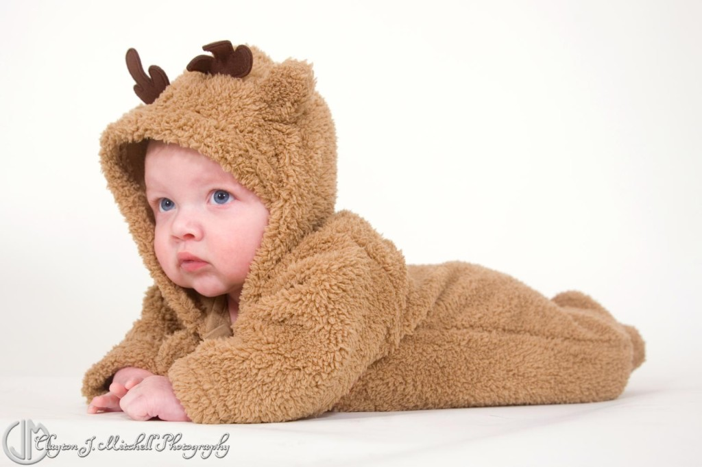 Baby in a reindeer costume