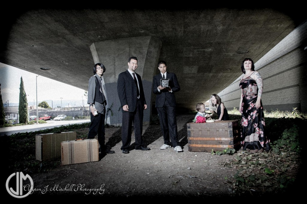 gritty and elegant family portrait under freeway overpass