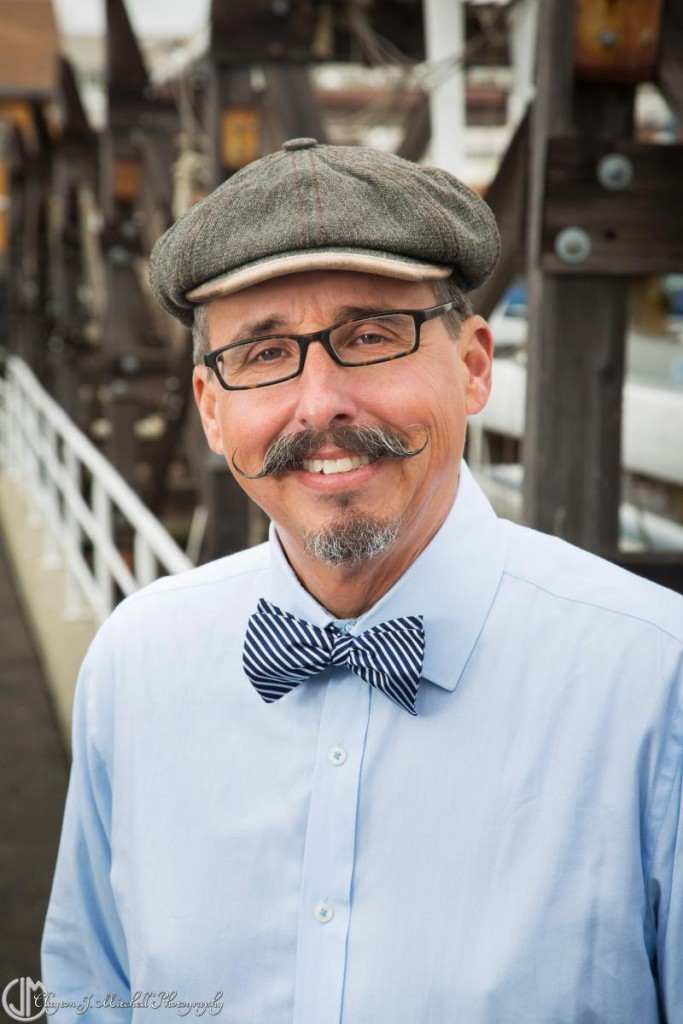 man wearing a hat and bowtie head shot