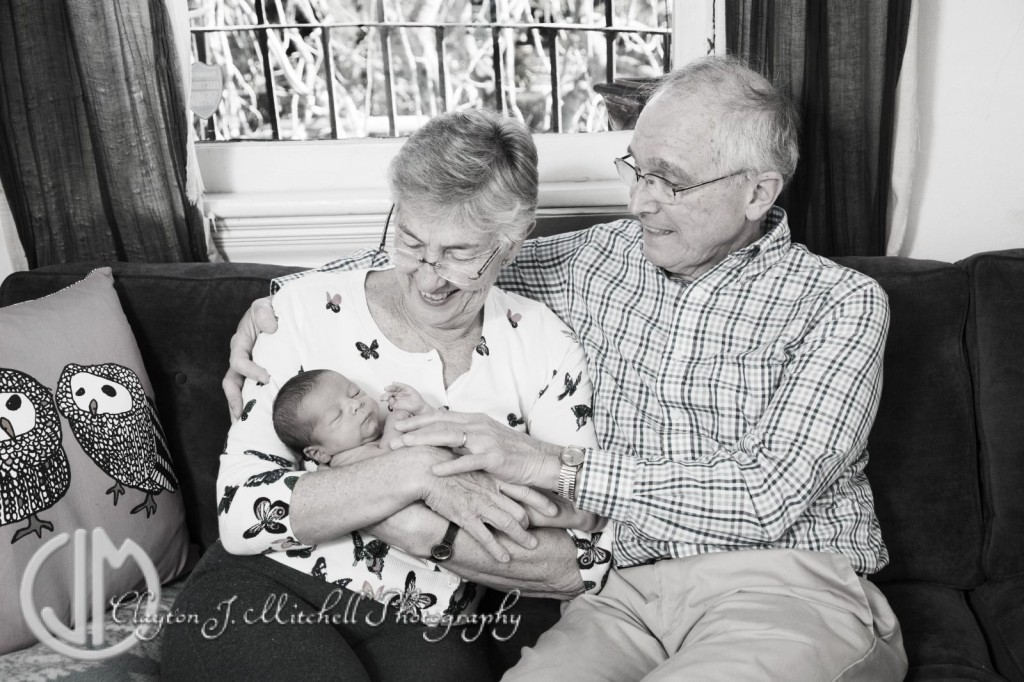 photo of grandparents and newborn