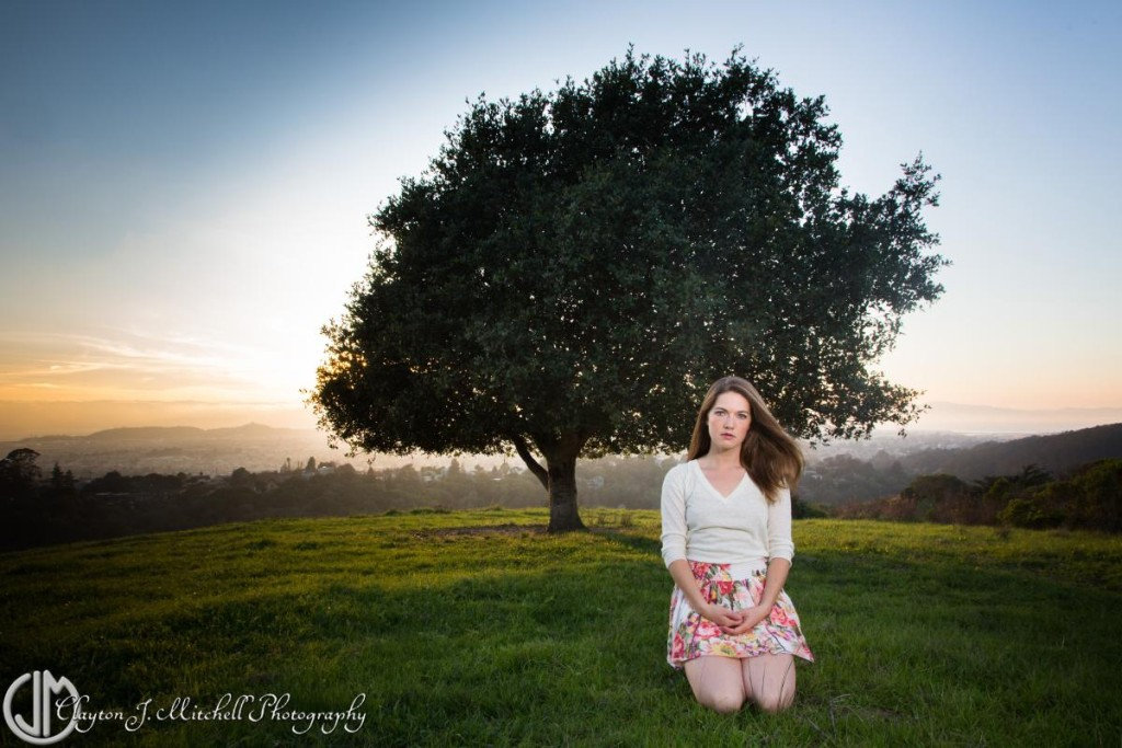 woman sitting by a tree in the east bay hills