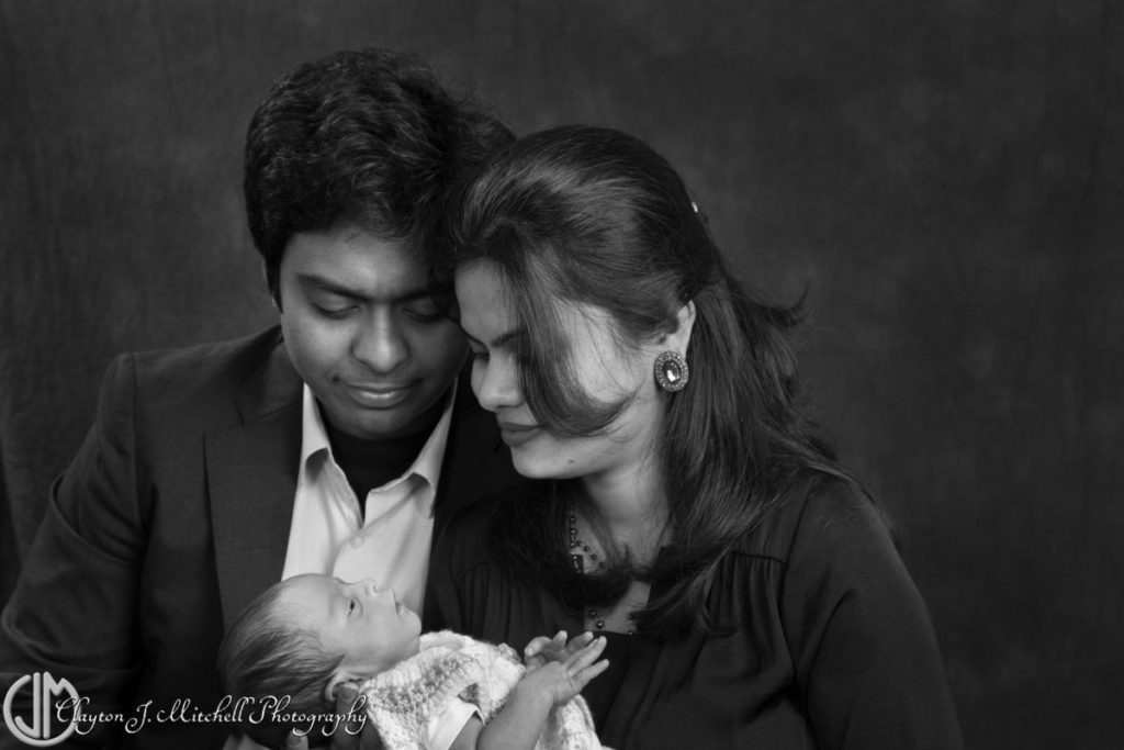 black and white family photo with newborn