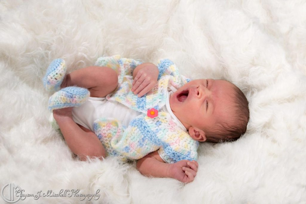 newborn baby yawning studio photography