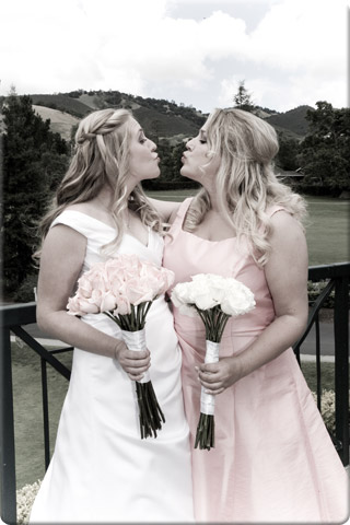 Bride and bridesmaid holding flowers