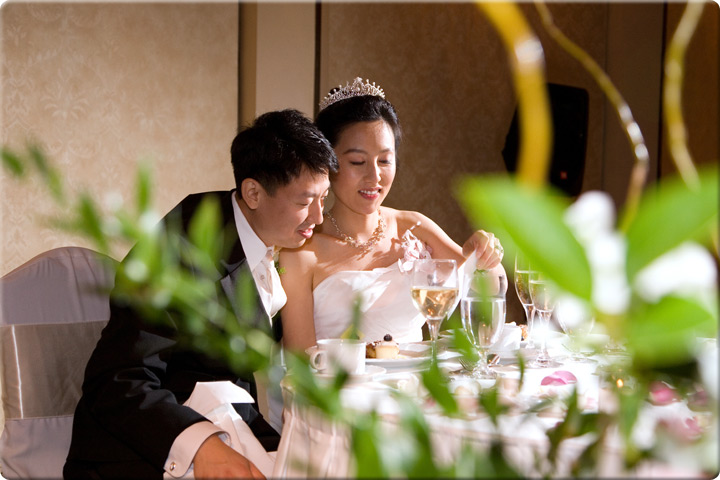 Bride and groom together at a table
