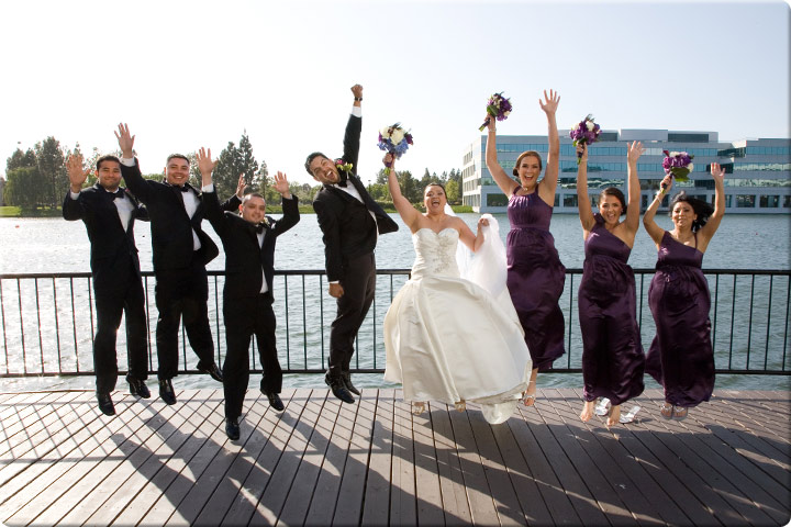 Jumping with the bride and groom