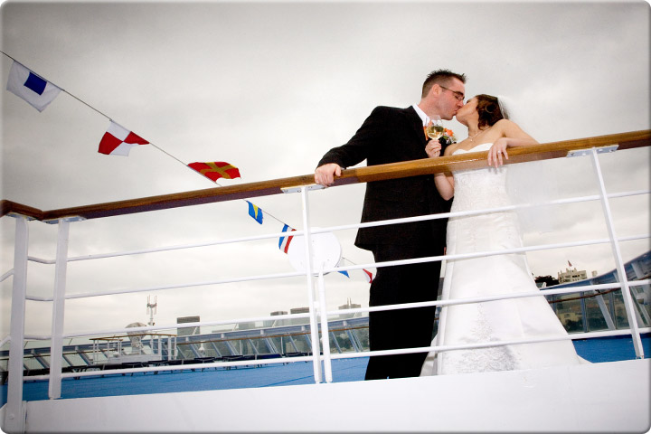 Kiss on the boat while holding champagne
