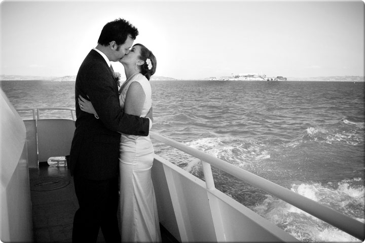 Kissing on a boat over the water