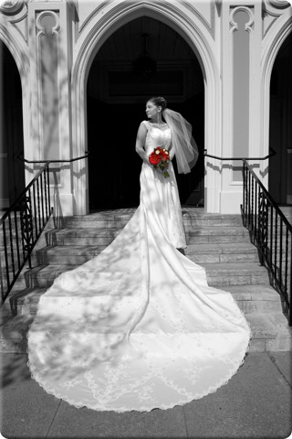 Bride with dress layed across the stairs